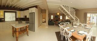 Panorama showing lounge, kitchen and dining room